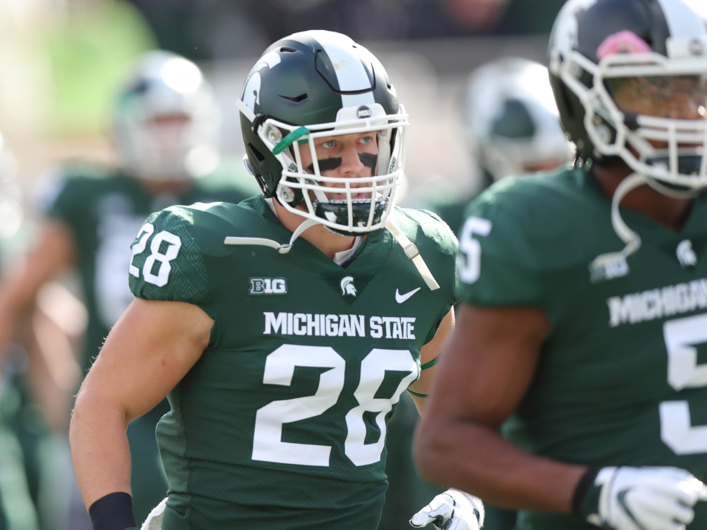 Michigan State's Jon Reschke warms up  before action against Michigan  on Saturday, Oct. 20, 2018, at Spartan Stadium in East Lansing, Mich.