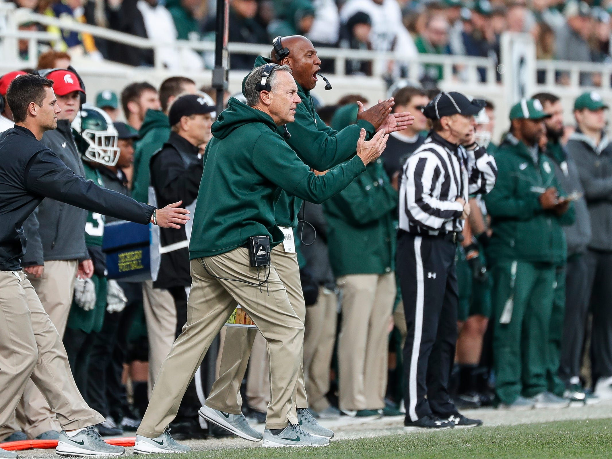Michigan State coach Mark Dantonio watches a play against Michigan during the first half at Spartan Stadium on Saturday, Oct. 20, 2018.