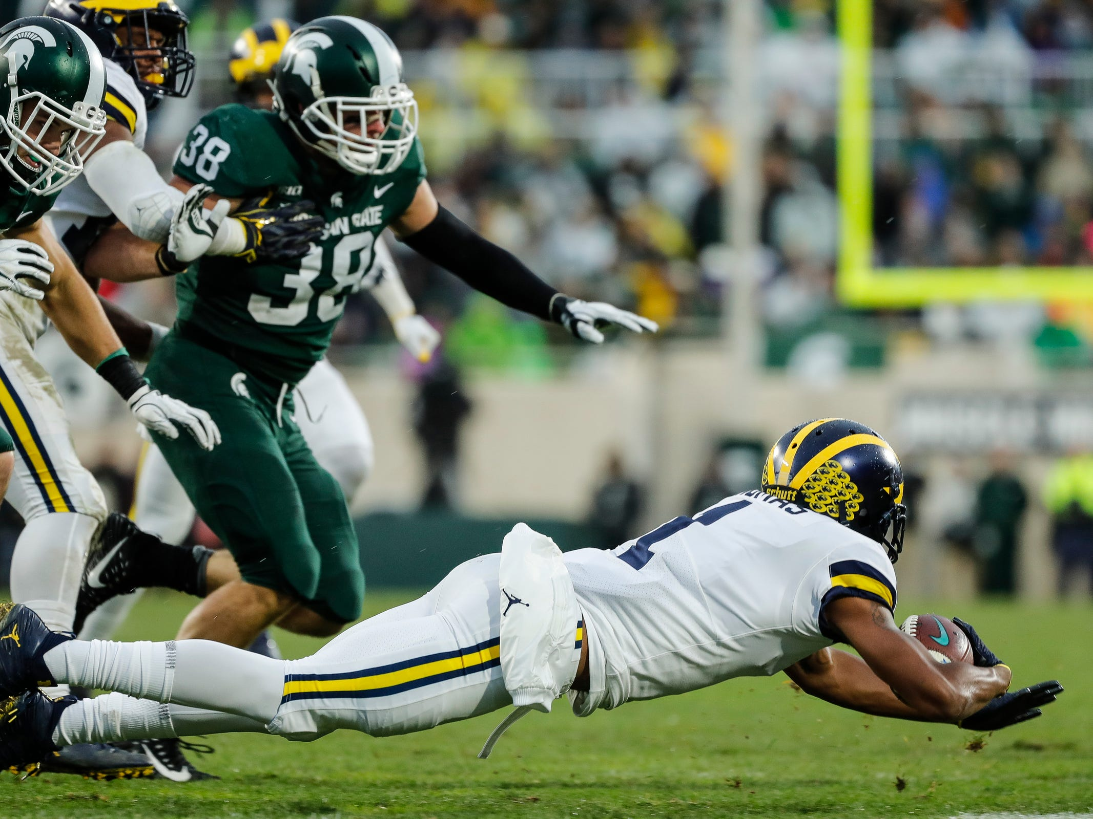 Michigan kick returner Ambry Thomas dives on a return against Michigan State during the second half at Spartan Stadium in East Lansing, Saturday, Oct. 20, 2018.