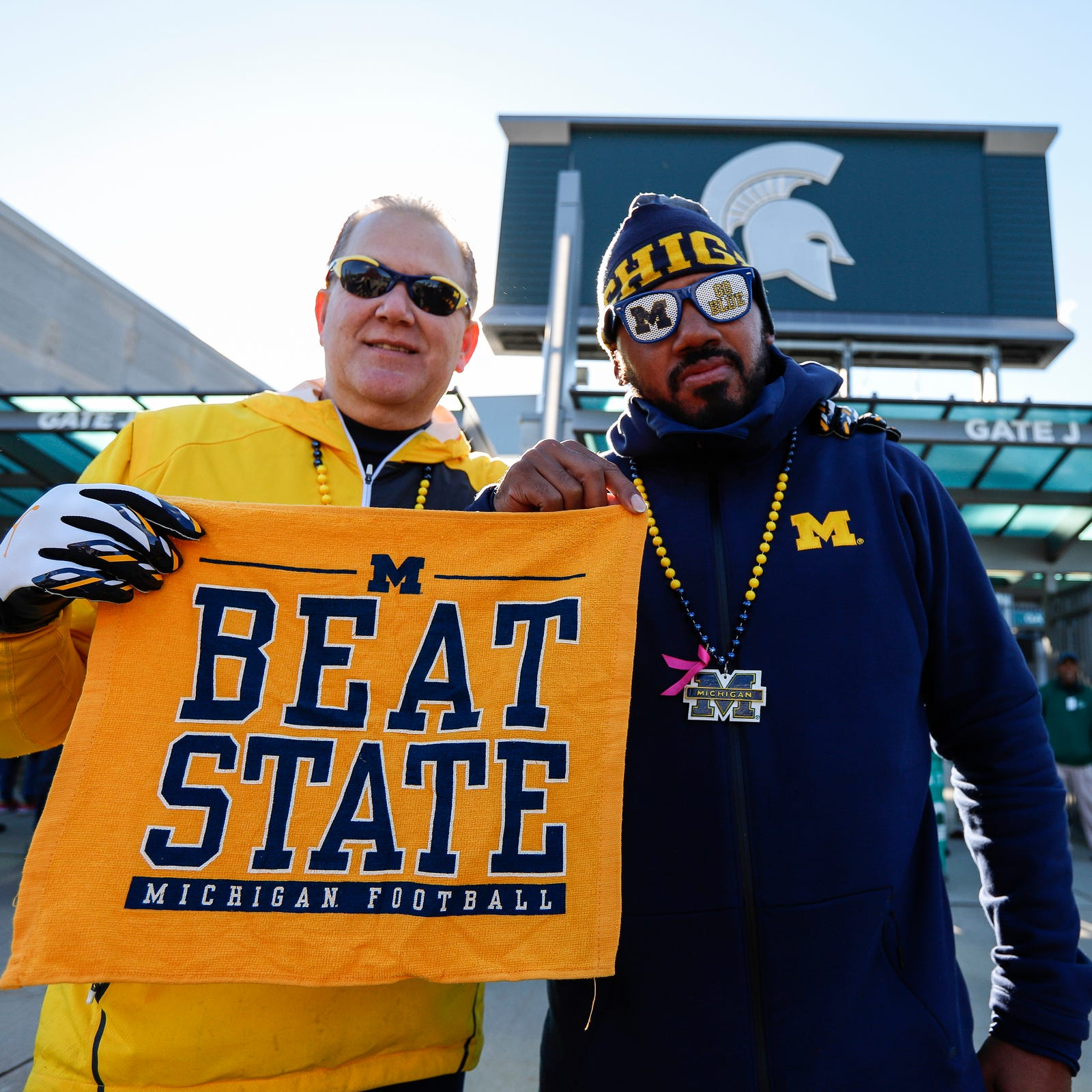 Ray Kopja of Howell, left, and Mike Diggs of Detroit, pose for a photo outside of the Spartan Stadium in East Lansing before the Michigan State game on Saturday, Oct. 20, 2018.