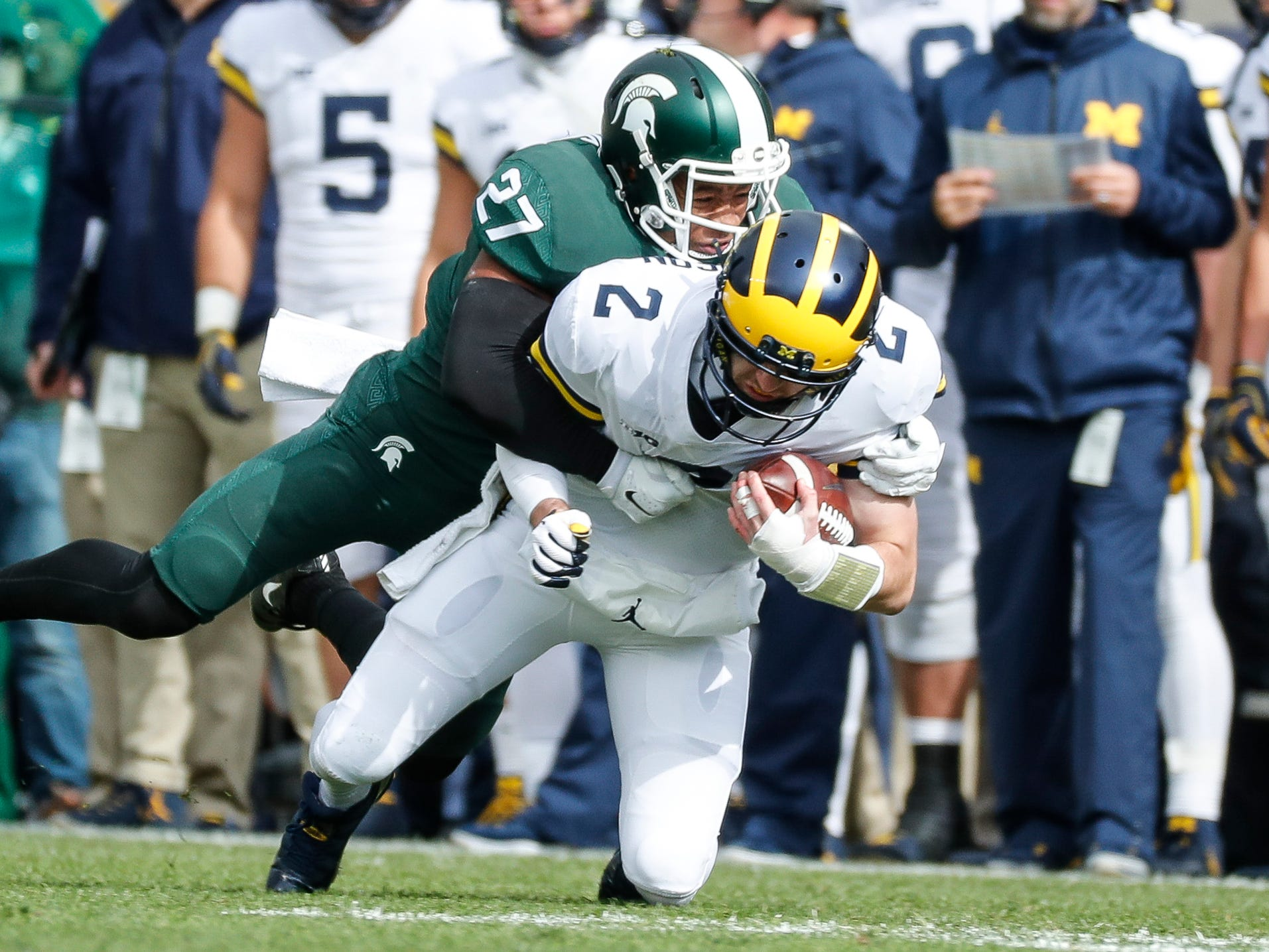 Michigan State safety Khari Willis tackles Michigan quarterback Shea Patterson during the first half at Spartan Stadium on Saturday, Oct. 20, 2018.