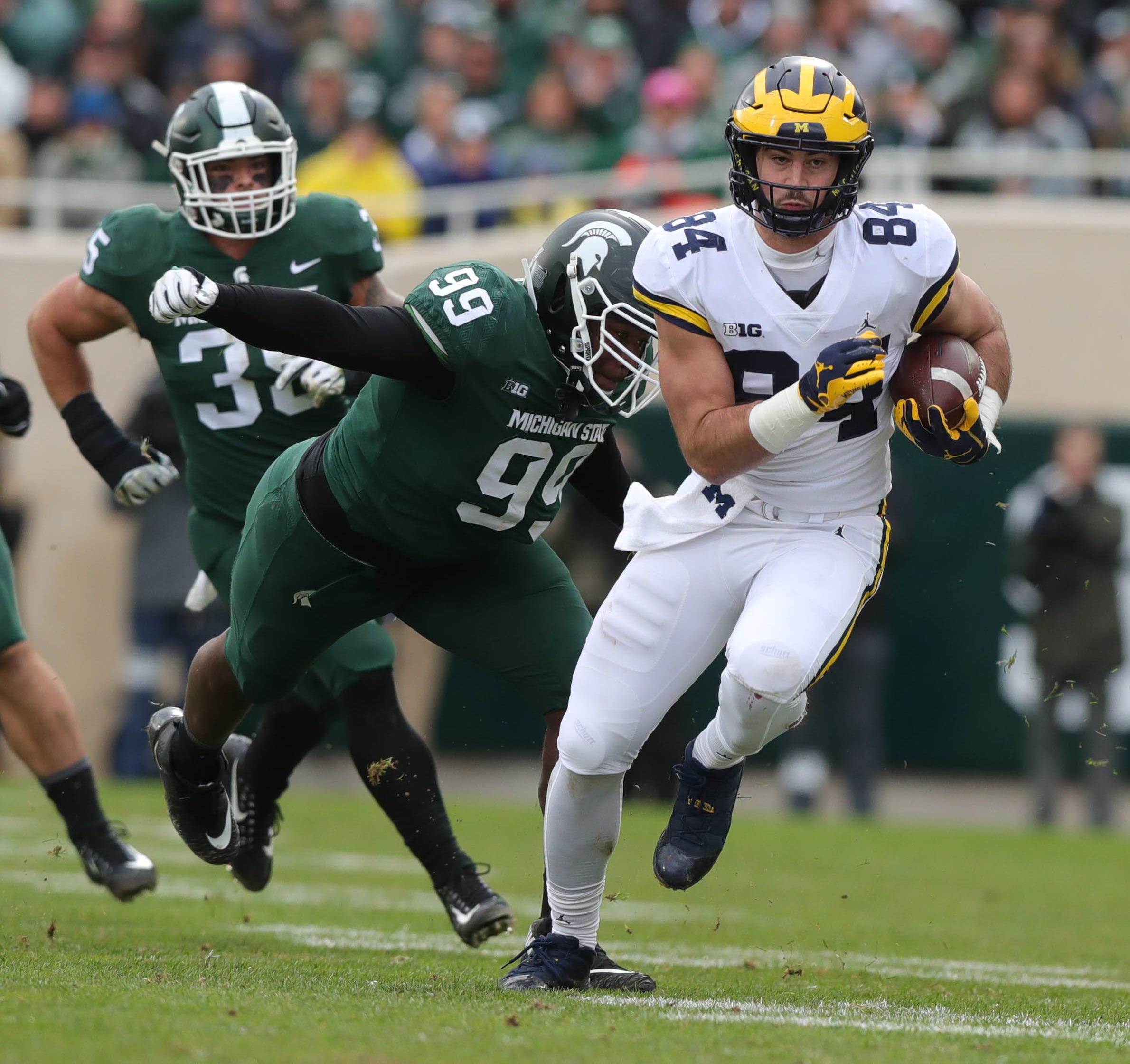 Michigan tight end Sean McKeon runs by Michigan State defensive lineman Raequan Williams during the first half in Spartan Stadium on Saturday, Oct. 20, 2018.