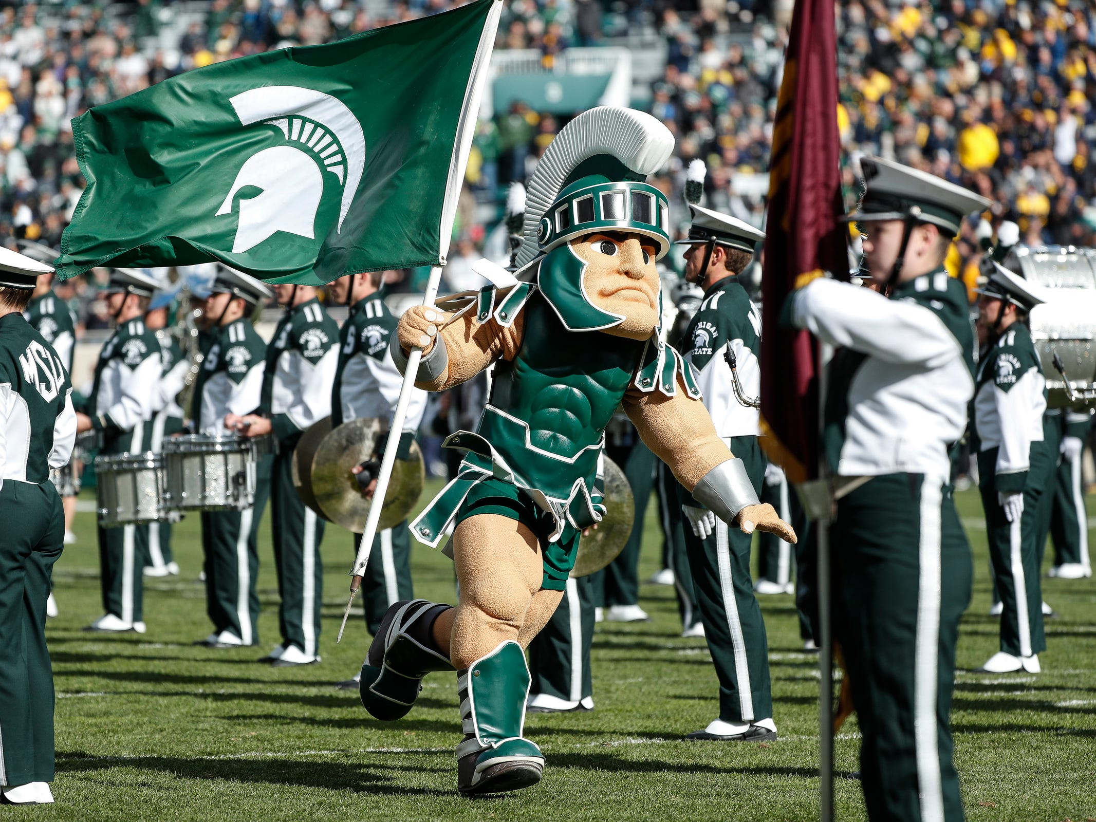 Sparty runs across the field before the Michigan game at Spartan Stadium on Saturday, Oct. 20, 2018.