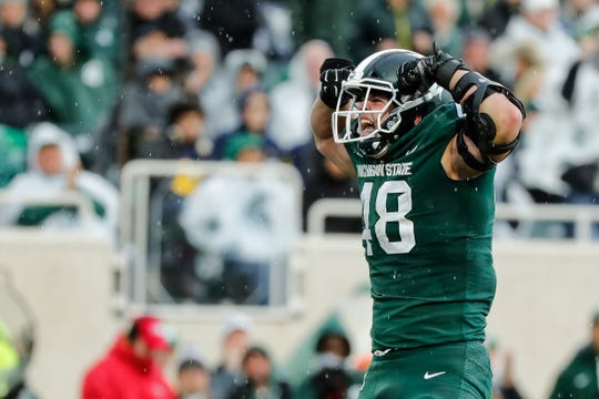 Michigan State defensive end Kenny Willekes celebrates a play against Michigan during the second half at Spartan Stadium in East Lansing, Saturday, Oct. 20, 2018.