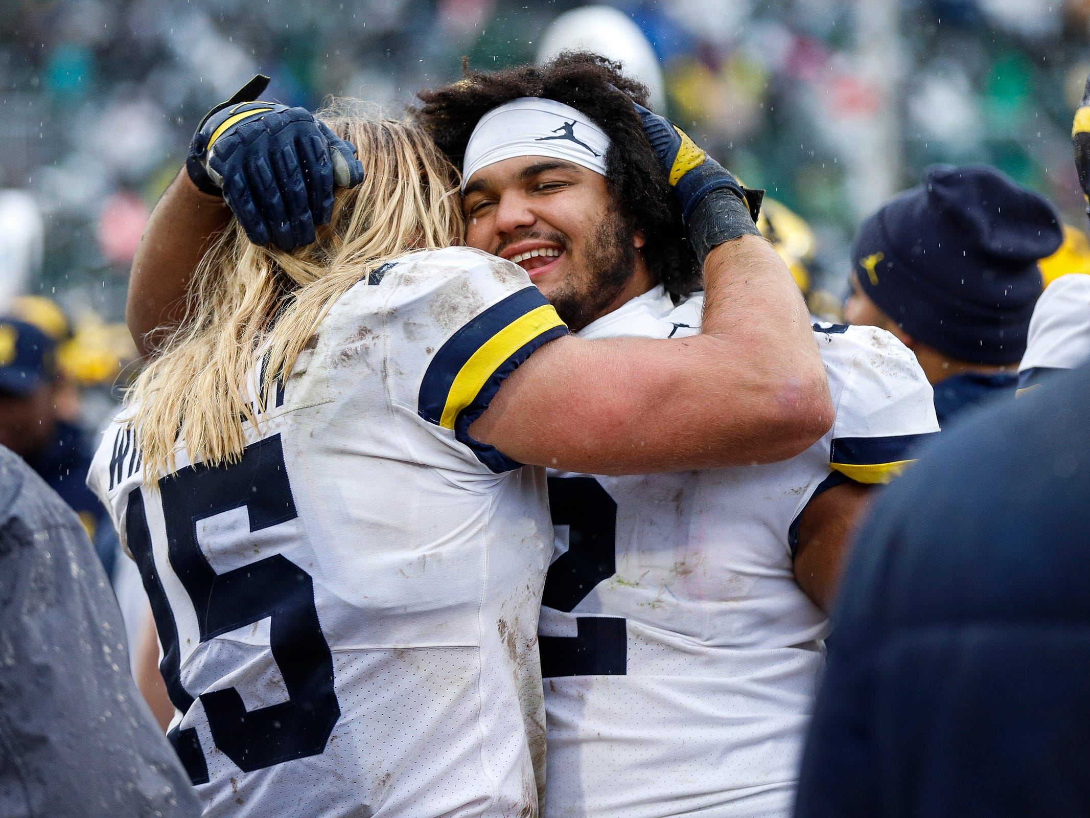 Michigan defensive lineman Chase Winovich, left, hugs defensive lineman Carlo Kemp during the second half against Michigan State at Spartan Stadium in East Lansing, Saturday, Oct. 20, 2018.