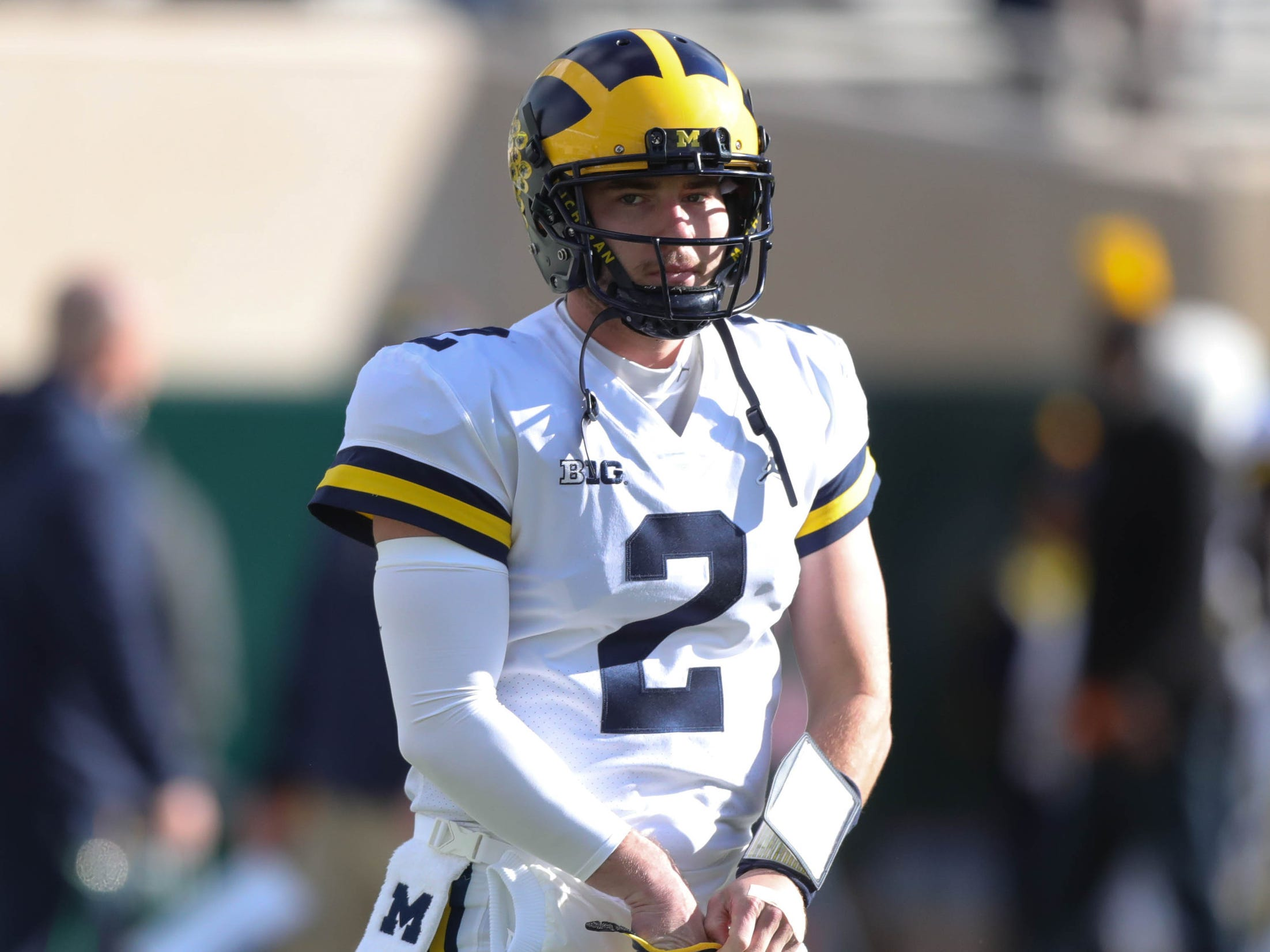 Michigan's Shea Patterson warms up before action against Michigan State on Saturday, Oct. 20, 2018, at Spartan Stadium in East Lansing, Mich.