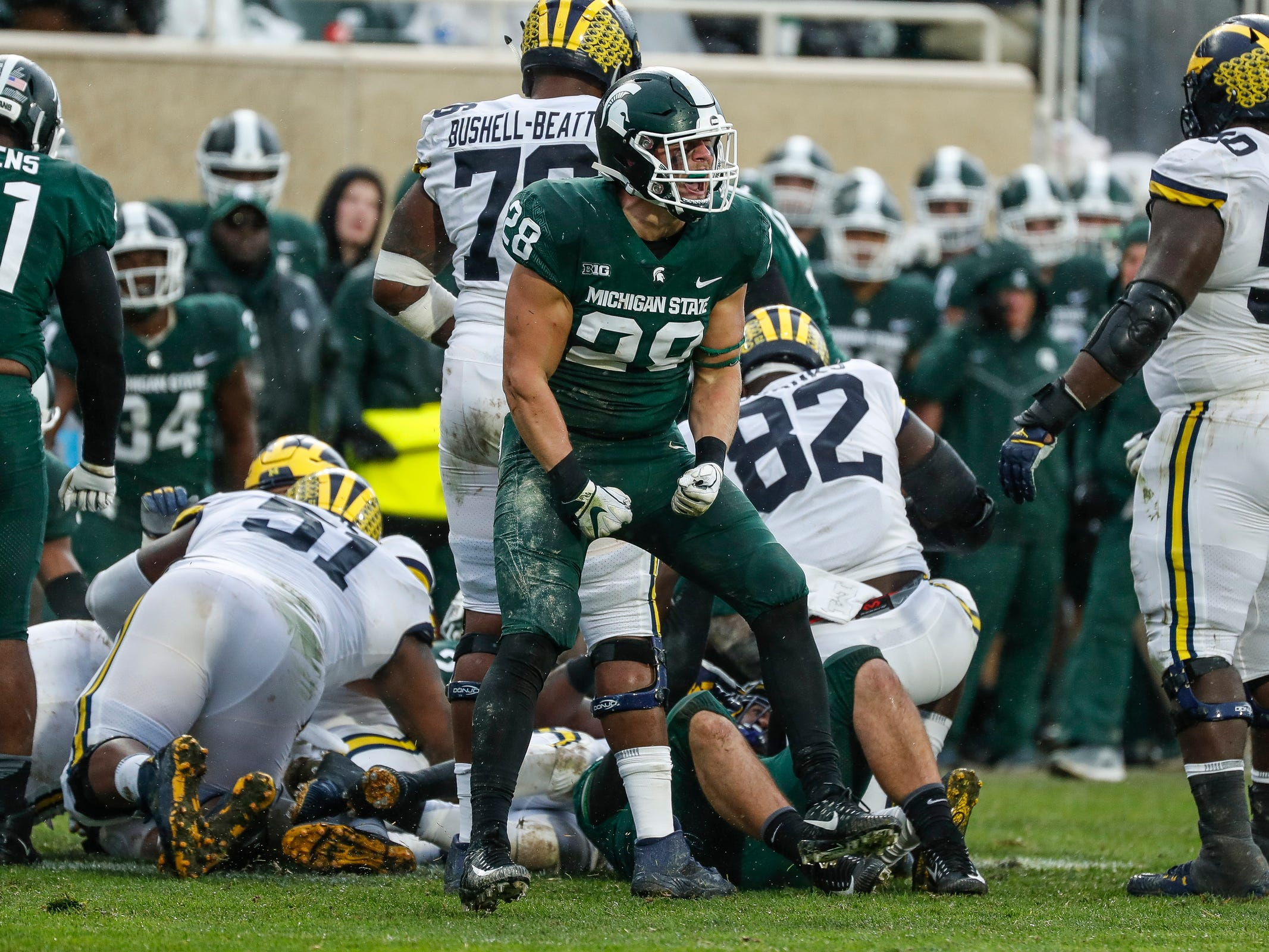 Michigan State linebacker Jon Reschke (28) celebrates a tackle against Michigan during the second half at Spartan Stadium in East Lansing, Saturday, Oct. 20, 2018.