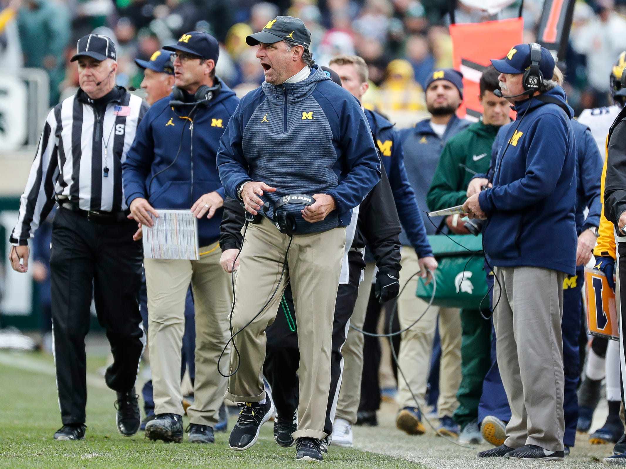 Michigan secondary/special team coach Michael Zordich, center, reacts to a play against Michigan State during the second half at Spartan Stadium in East Lansing, Saturday, Oct. 20, 2018.