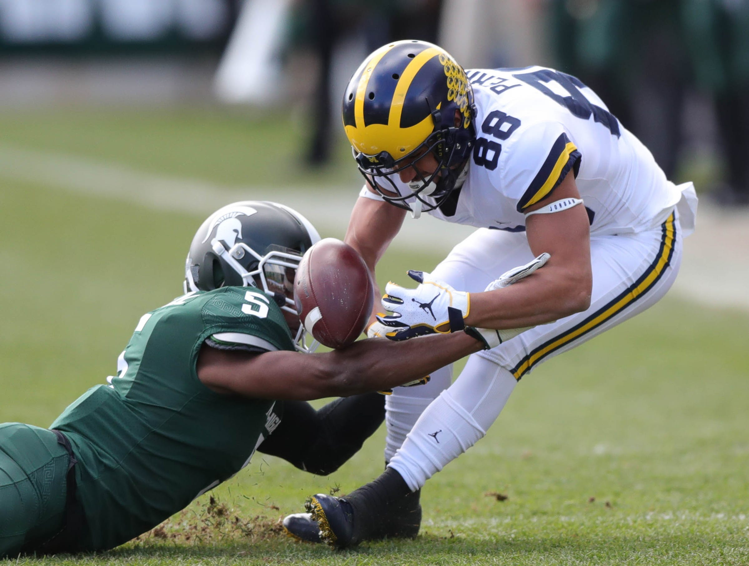 Michigan wide receiver Grant Perry is defended by Michigan State's Andrew Dowell during the first half on Saturday, Oct. 20, 2018, at Spartan Stadium.