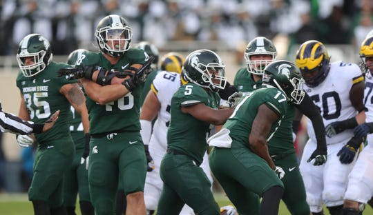 Michigan State's Kenny Willekes celebrates after a stop against Michigan during the first half on Saturday, Oct. 20, 2018, at Spartan Stadium.