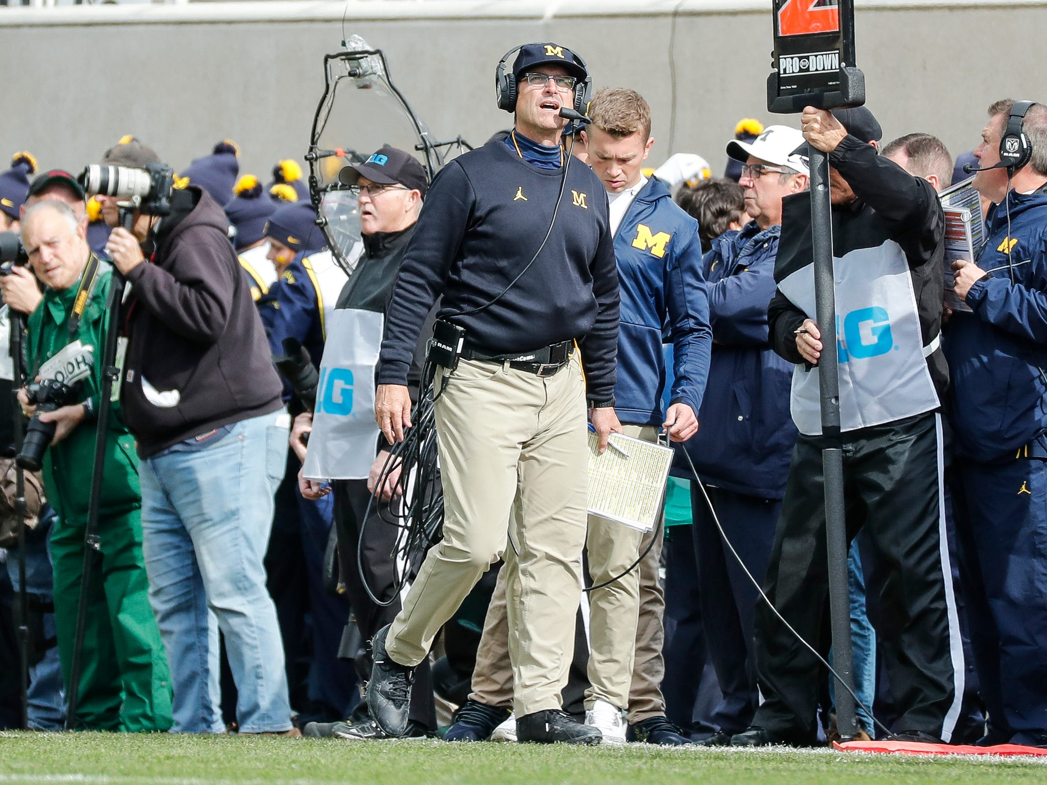 Michigan coach Jim Harbaugh looks up during the first half against Michigan State at Spartan Stadium on Saturday, Oct. 20, 2018.
