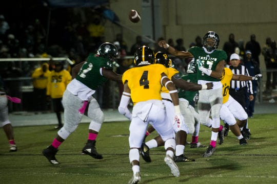Cass Tech quarterback Jalen Graham, 17, throws a pass during the city championship against King at Renaissance High School in Detroit on Friday, Oct. 19, 2018. At the end of the 1st quarter Cass was winning 7-0.