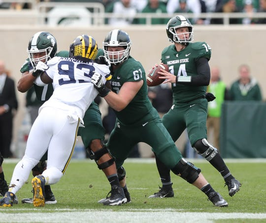 Michigan State quarterback Brian Lewerke looks to pass against Michigan during the first half on Saturday, Oct. 20, 2018, at Spartan Stadium.