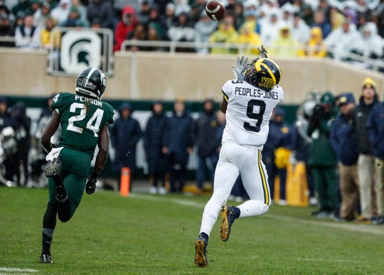 Michigan's Donovan Peoples-Jones catches a pass against Michigan State's Tre Person that went for a 79-yard go-ahead TD in the third quarter at Spartan Stadium in East Lansing, Saturday, Oct. 20, 2018.