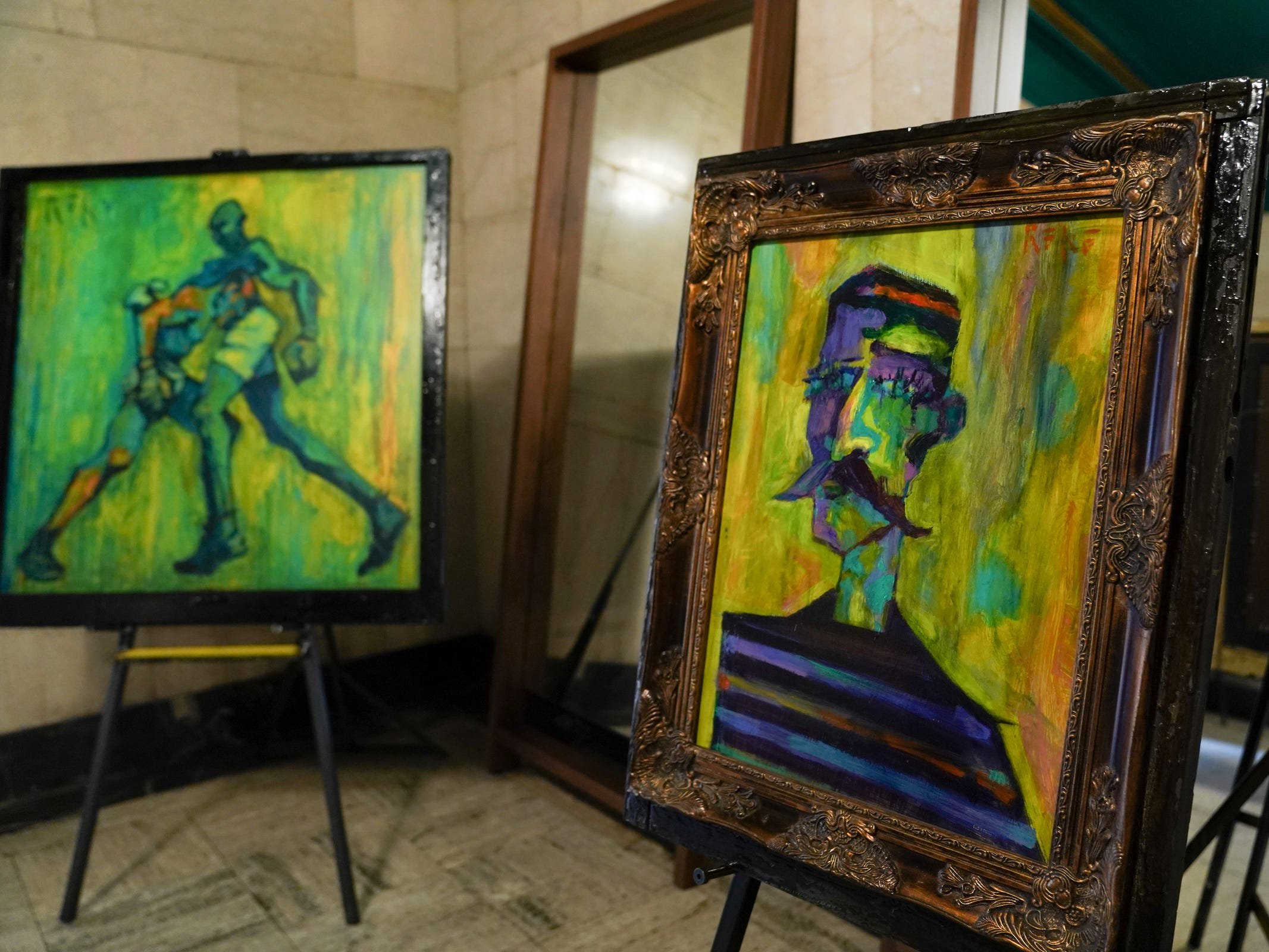 "Paintings ""The Last Round"" and ""Rugby Player"" by artist Tony Roko is on display at the Detroit Foundation Hotel in downtown Detroit on Friday, October 12, 2018."