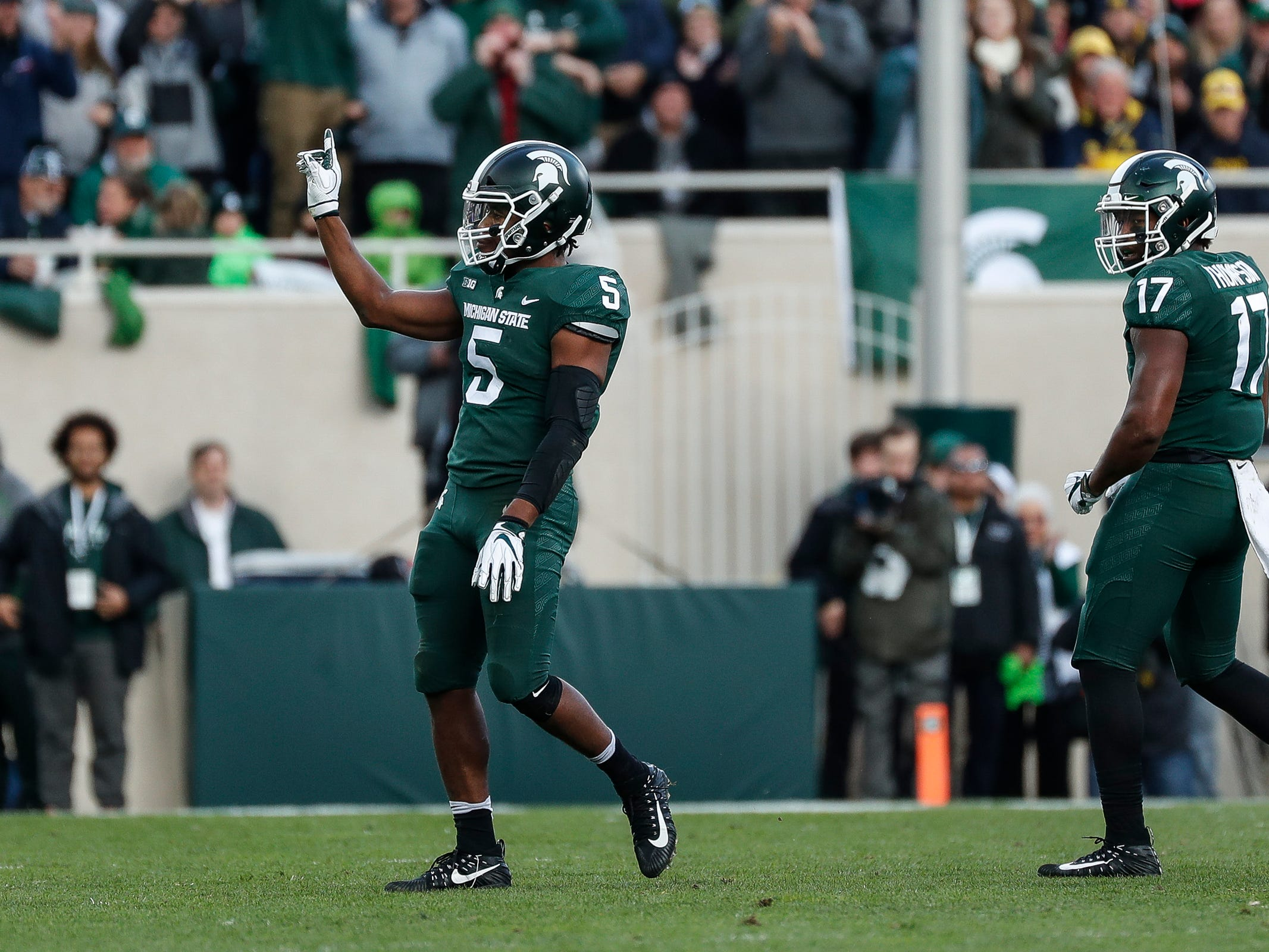Michigan State linebacker Andrew Dowell celebrates a tackle against Michigan during the first half at Spartan Stadium on Saturday, Oct. 20, 2018.