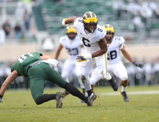 Michigan linebacker Josh Uche rushes Michigan State QB Brian Lewerke during the first half in Spartan Stadium on Saturday, Oct. 20, 2018.