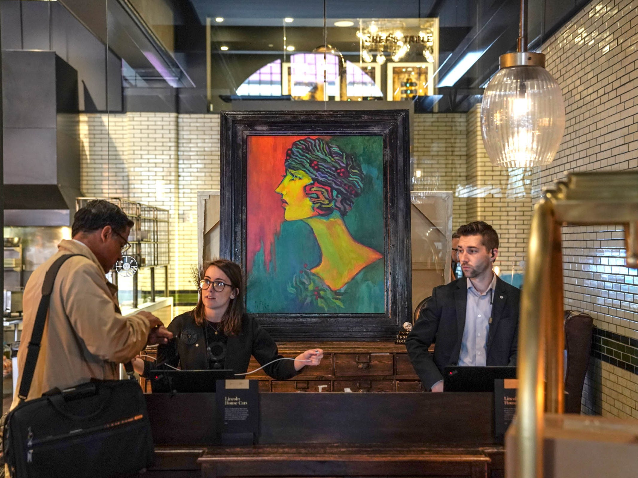 "A painting titled ""Mila"" by artist Tony Roko is on display at the Detroit Foundation Hotel in downtown Detroit on Friday, October 12, 2018."