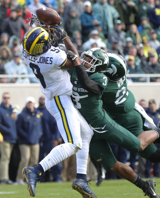 Michigan wide receiver Donovan Peoples-Jones is defended by Michigan State safety Xavier Hudson during the first half in Spartan Stadium on Saturday, Oct. 20, 2018.