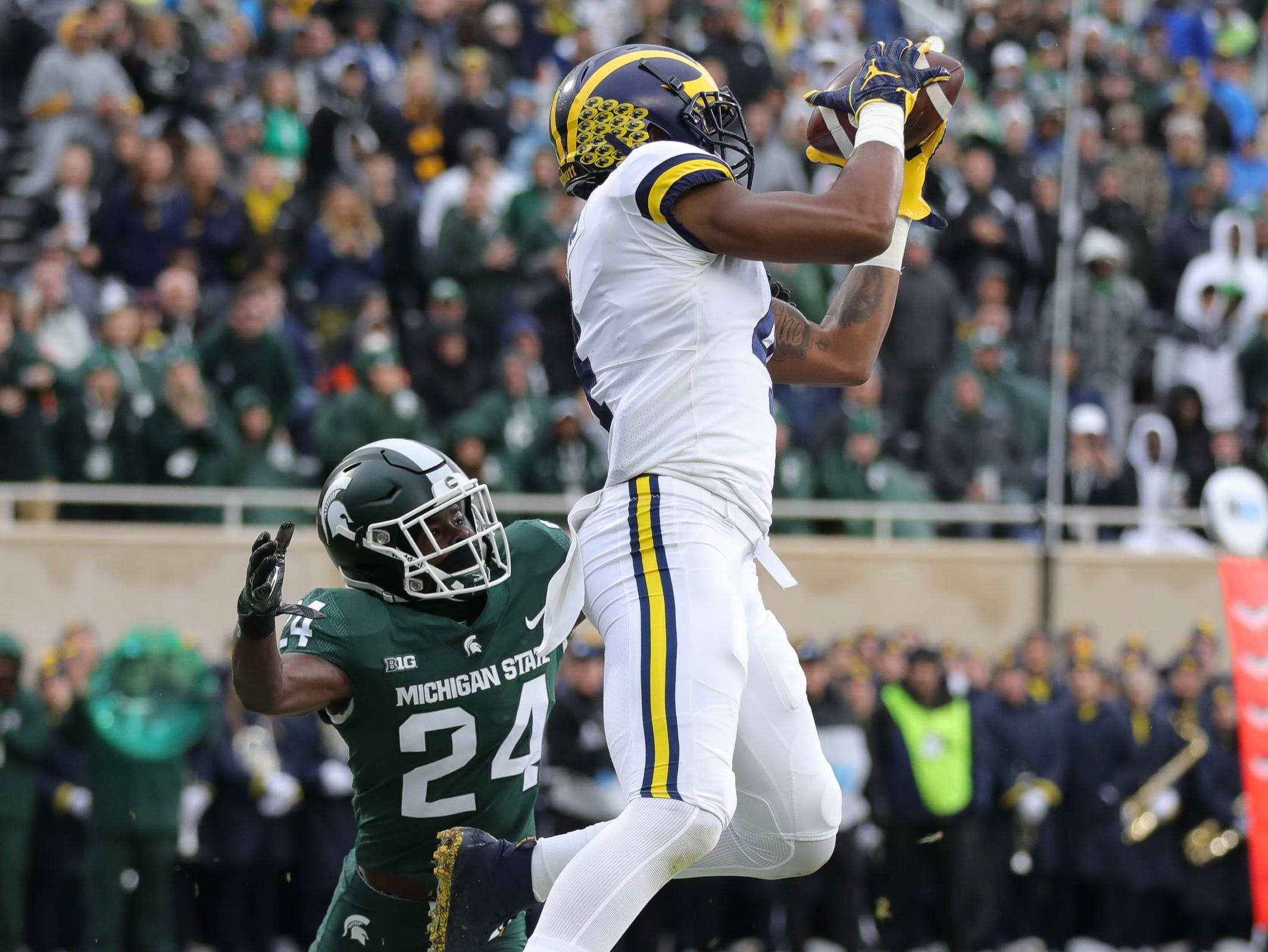 Michigan wide receiver Nico Collins catches a touchdown against Michigan State defensive back Tre Person during the first half in Spartan Stadium on Saturday, Oct. 20, 2018.