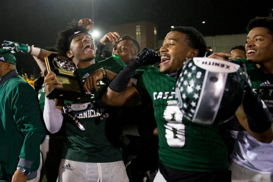 Cass Tech players Jeran Mangham, 1, and Tyler Milliner, 8, celebrate their victory over King during the city championship against Cass Tech at Renaissance High School in Detroit on Friday, Oct. 19, 2018. Cass Tech won 42-8.
