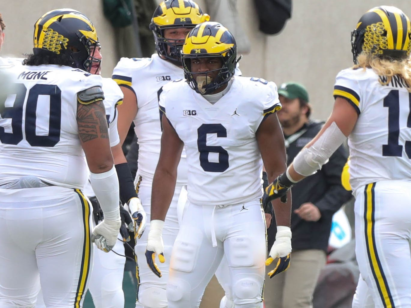 Michigan linebacker Josh Uche celebrates after a sack during the first half action against Michigan State on Saturday, Oct. 20, 2018, at Spartan Stadium.
