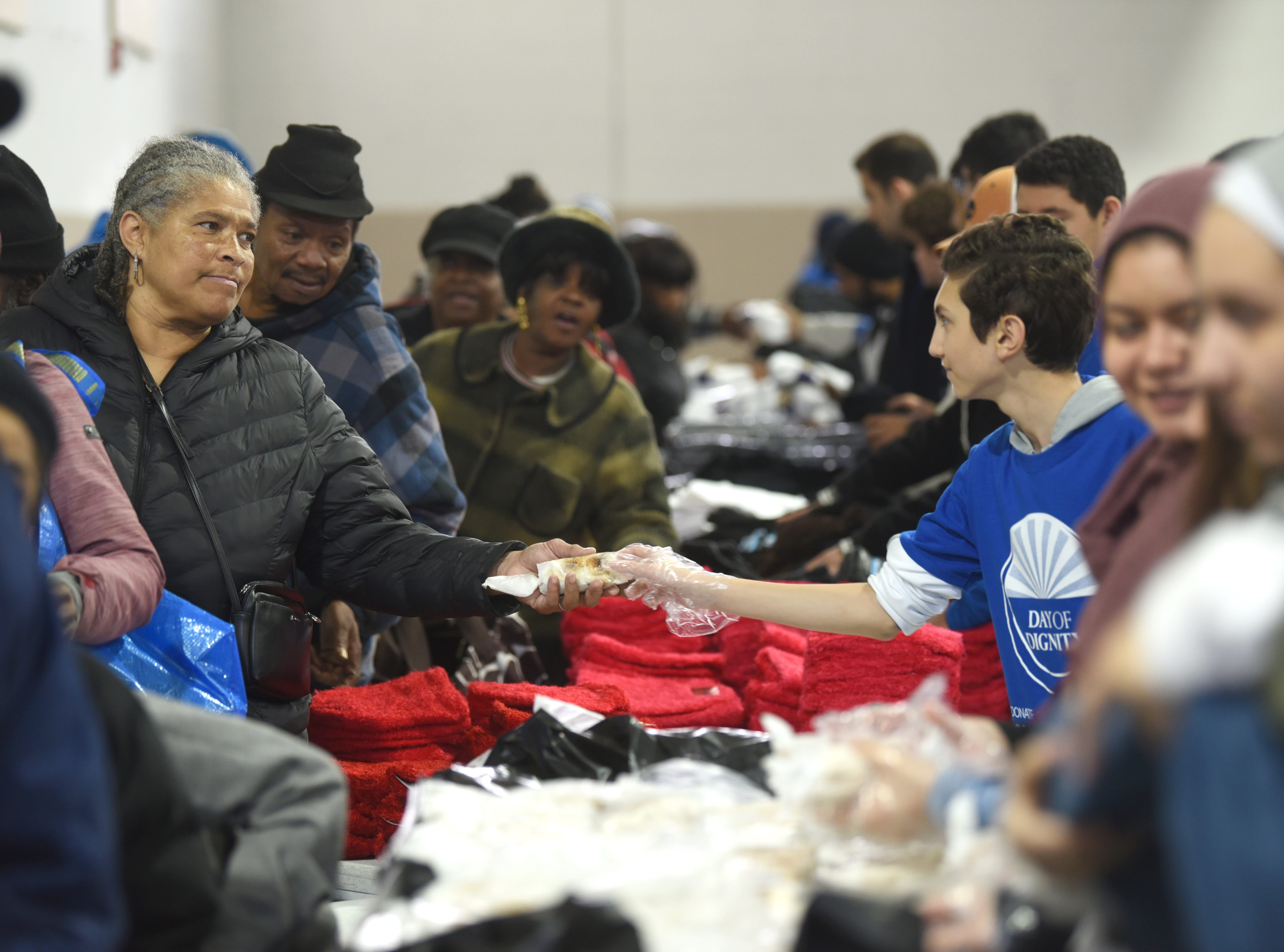 Dozens of people were helped with access to meals, winter coats, hygiene kits, and health screenings during Islamic Relief USA's Day of Dignity held at the Muslim Center Mosque and Community Center in Detroit.