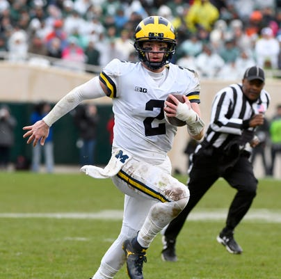 c9b6f7d2666 Michigan quarterback Shea Patterson takes off for a first down in the  second half. (Photo: Rod Sanford, Detroit News)
