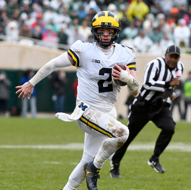 Michigan quarterback Shea Patterson takes off for a first down in the second half.