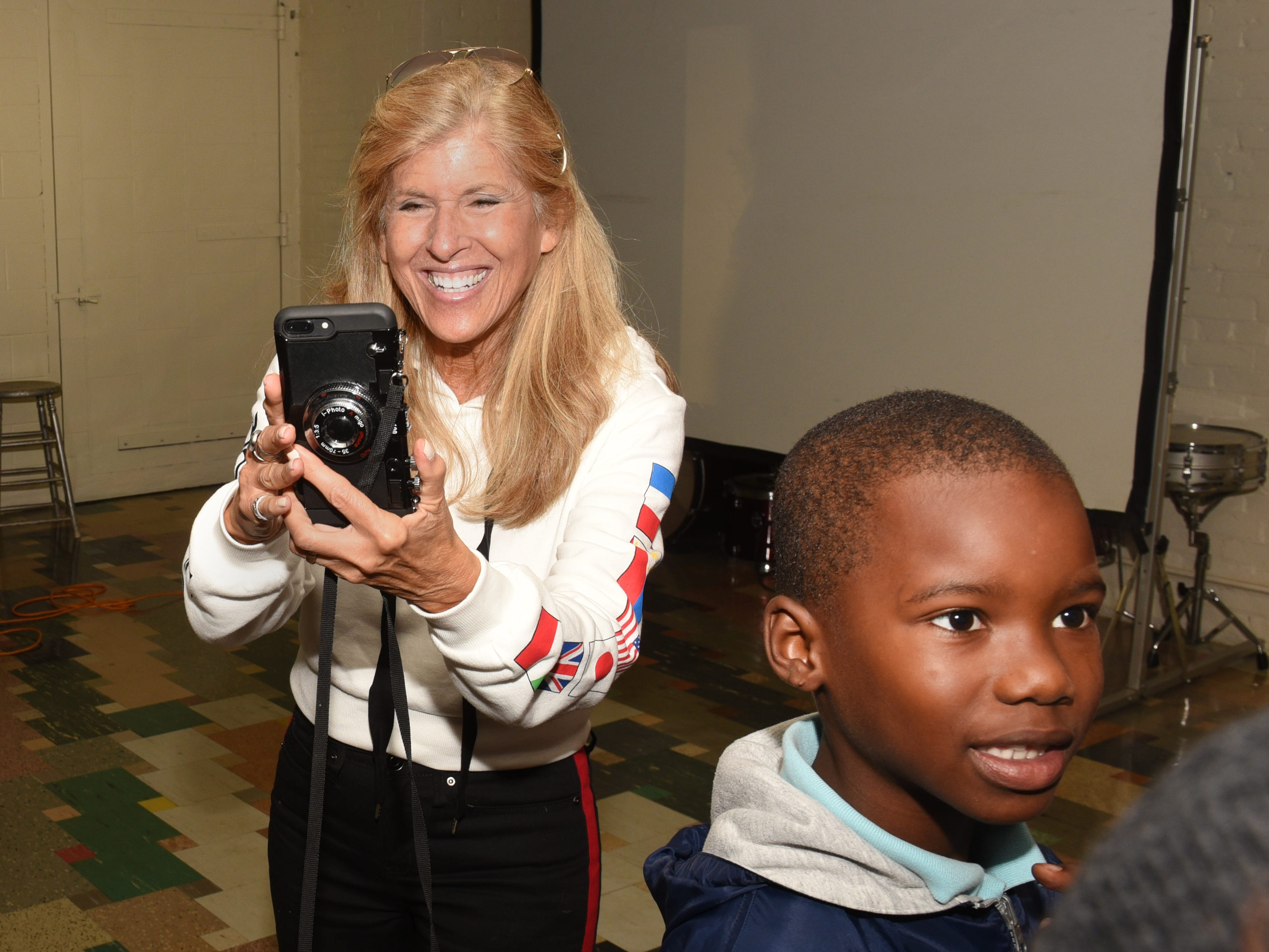 Photographer Linda Solomon takes pictures as she provides a photography lesson for homeless children held at the Cass Community Social Services World Building in Detroit on October 20, 2018.