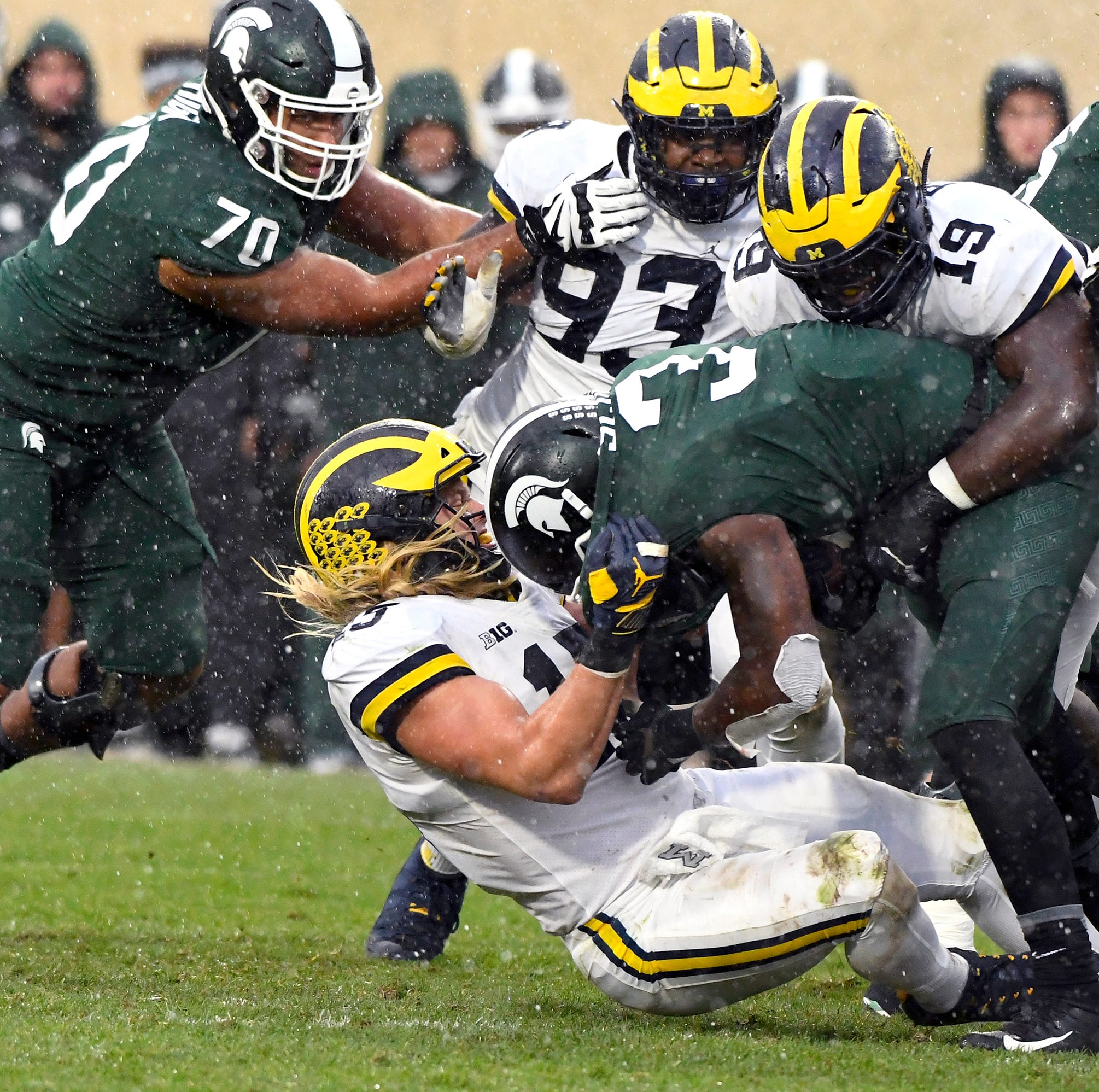Wolverines stifle Spartans in rivalry showdown