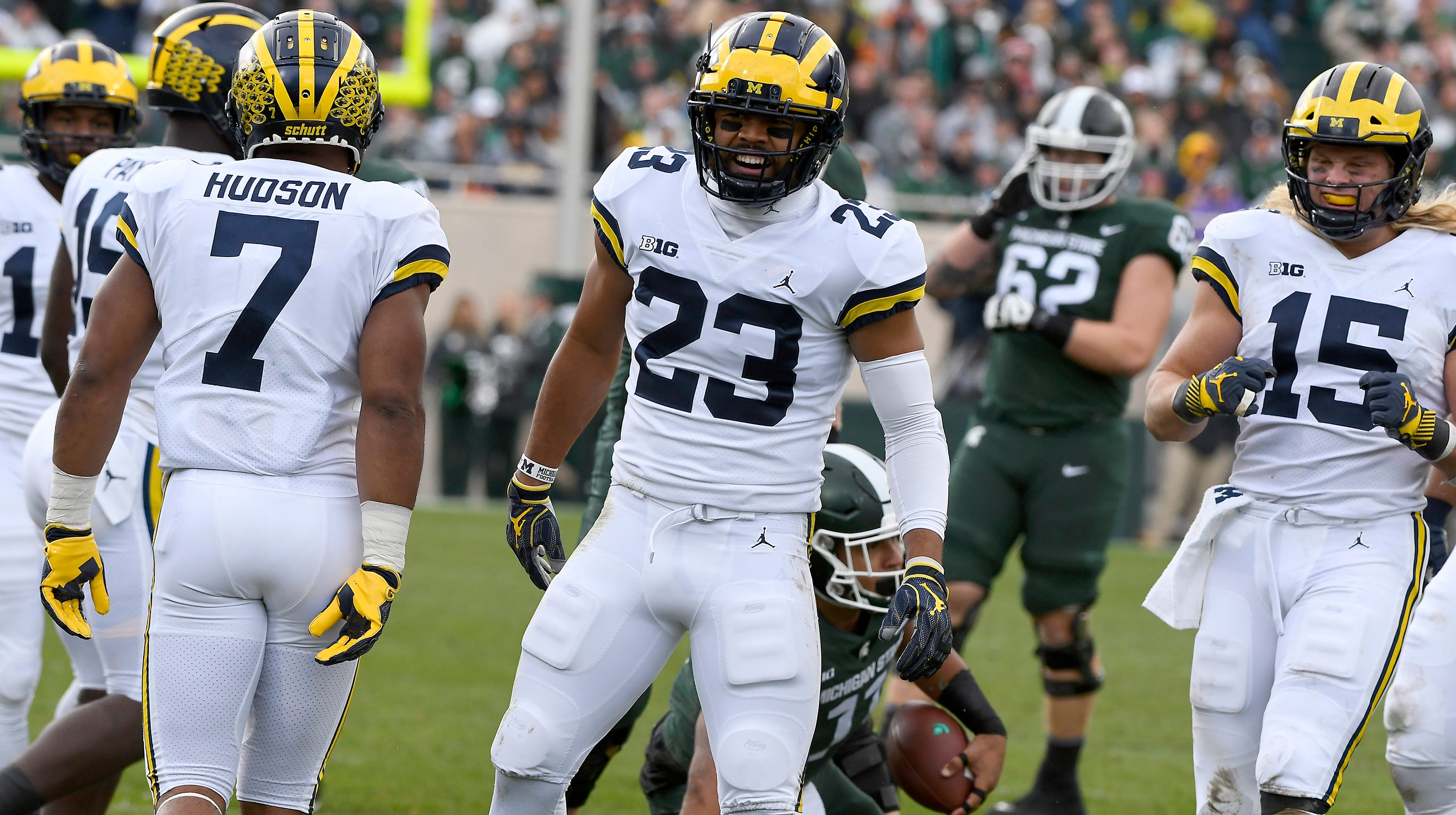 Michigan's Tyree Kimmel celebrates  a  defensive stop against the Spartans.
