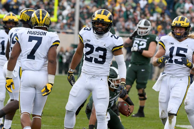 Michigan's Tyree Kinnel celebrates a defensive stop against Michigan State on Saturday.