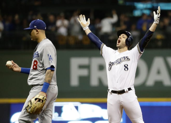 Brewers' Ryan Braun reacts after hitting an RBI double during the second inning of Game 6 of the National League Championship Series on Friday.