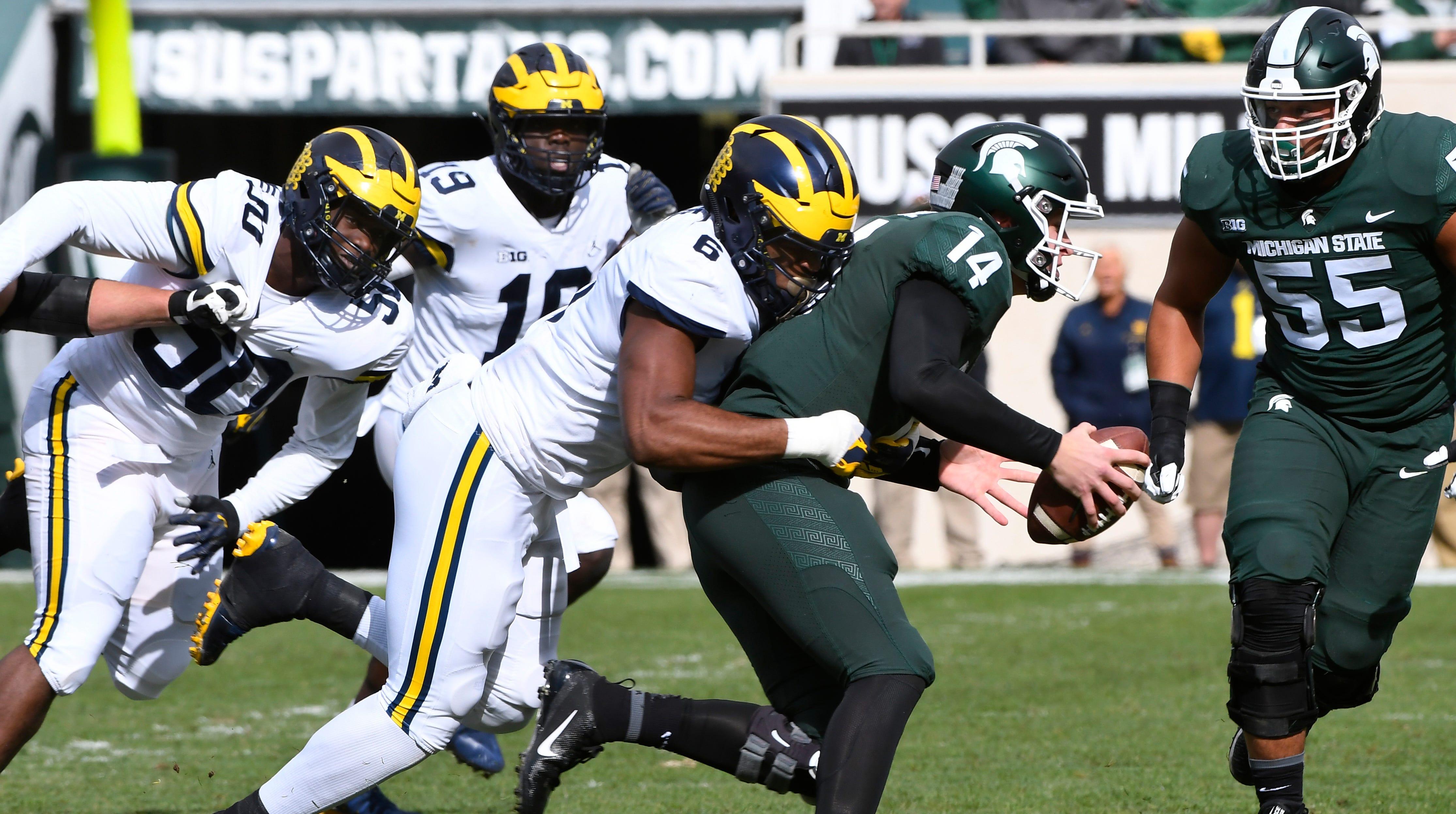 Michigan's Josh Uche (6) sacks Michigan State quarterback Brian Lewerke in the first quarter.