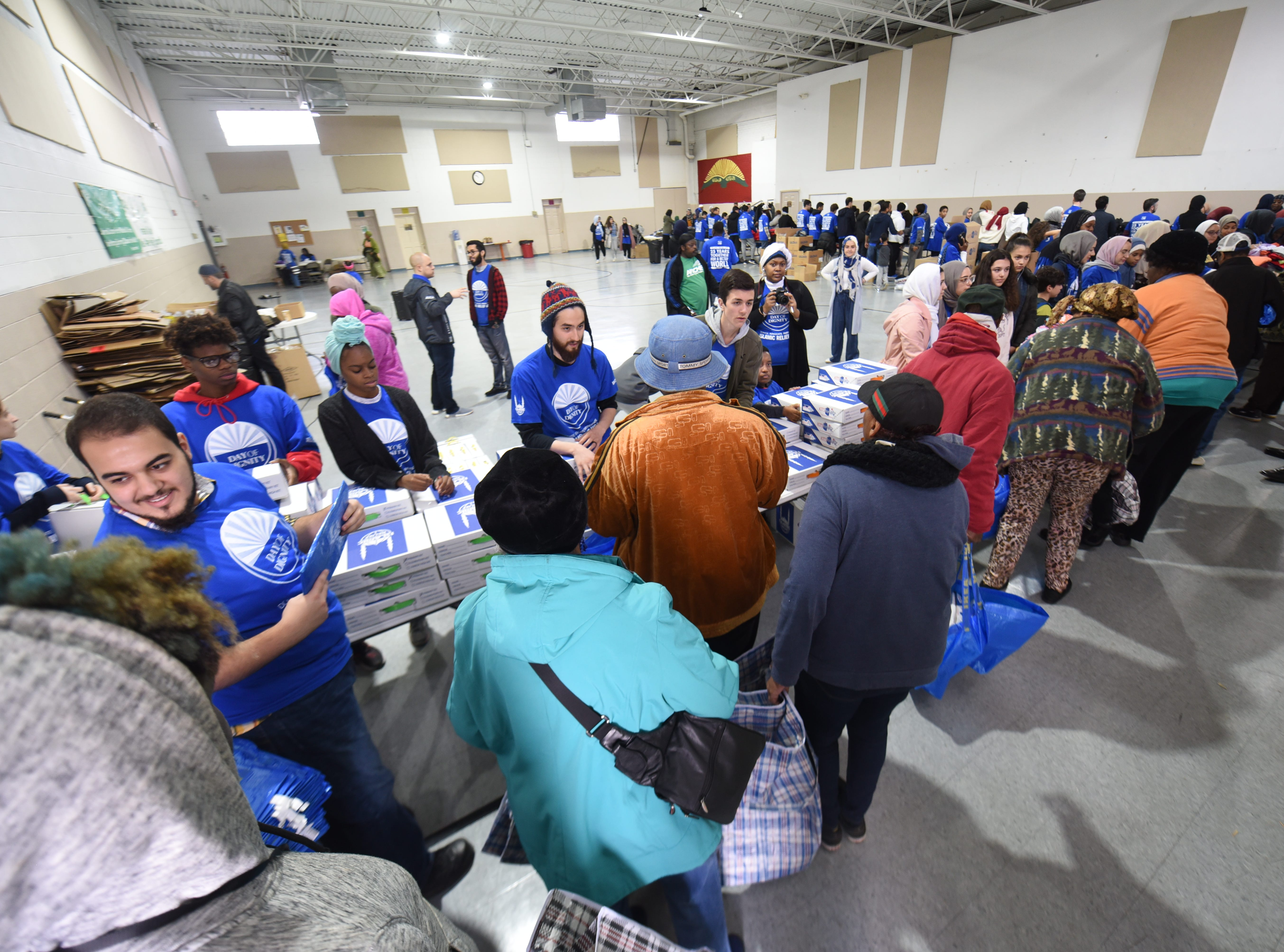 Participants wait in line during the  Islamic Relief USA's Day of Dignity campaign held at the Muslim Center Mosque and Community Center in Detroit.