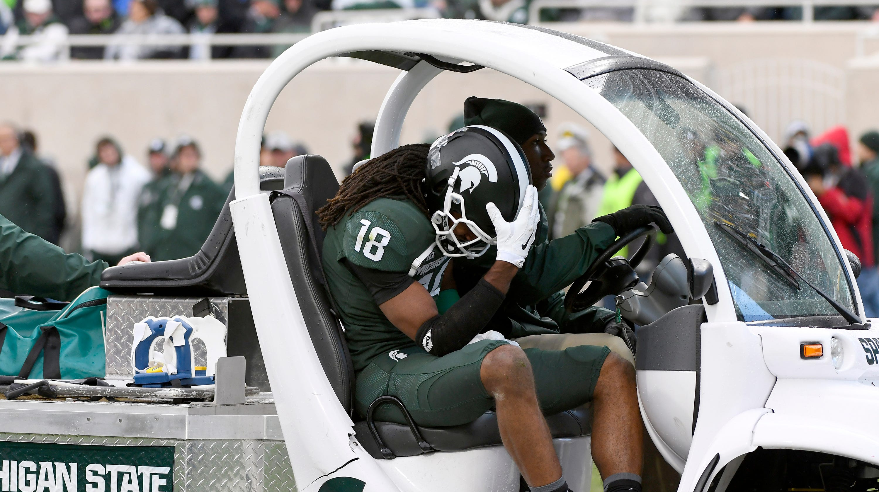 Michigan State receiver Felton Davis III leaves the field with a season-ending injury to his achilles tendon.