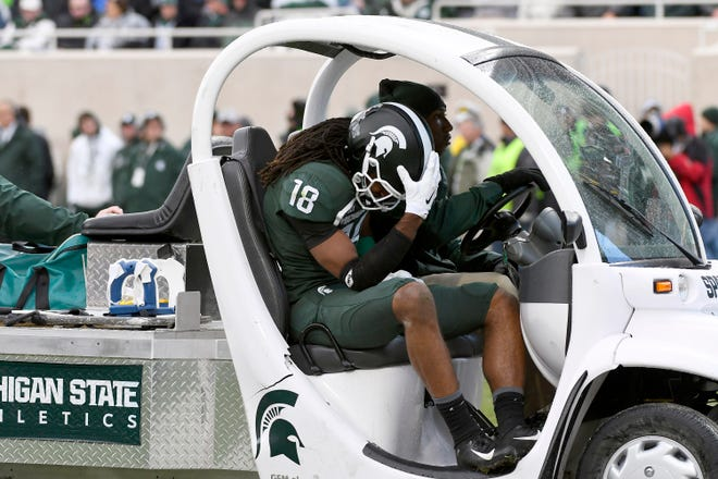 Michigan State receiver Felton Davis III leaves the field with an Achilles injury.