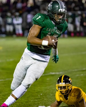 Jalen Graham (17) of Cass Tech runs against King in the first quarter.