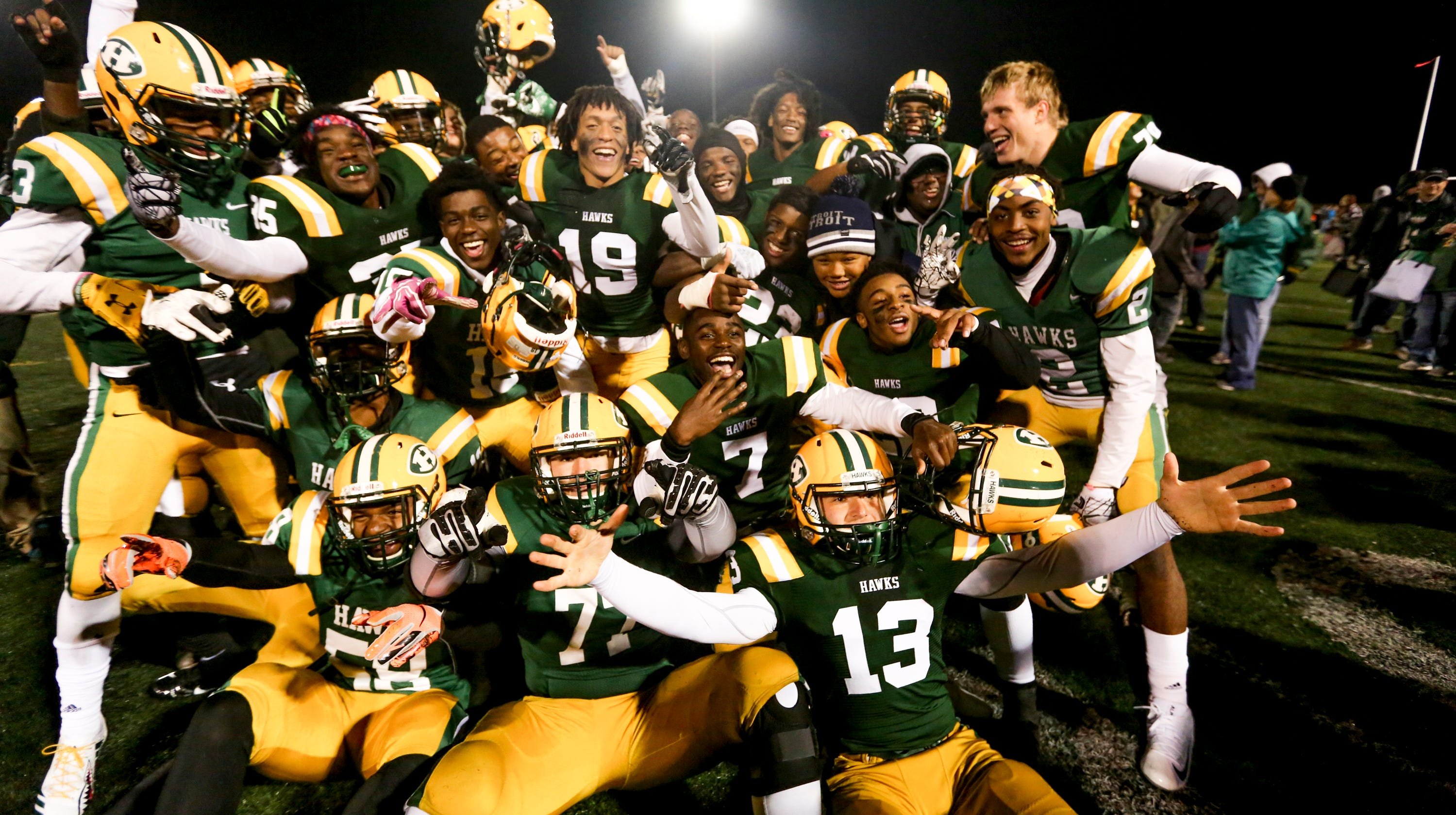 Farmington Hills Harrison celebrates Friday's 48-7 win over Farmington, which enabled Harrison to secure a state playoff spot in its final year.