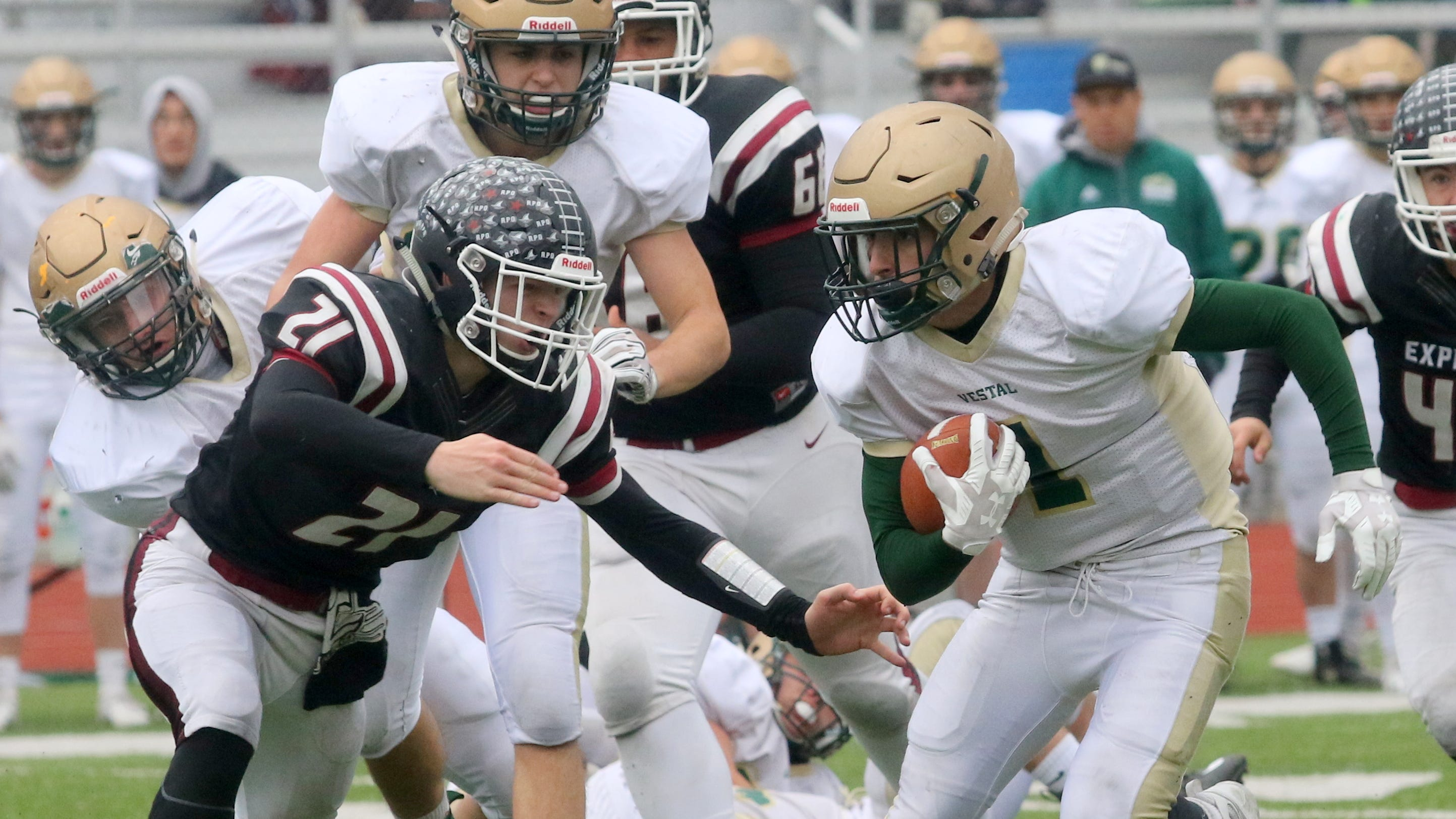 Matt Thrasher of Vestal carries the ball as Nate Latshaw of Elmira tries to make the tackle during the Golden Bears' 30-28 win Oct. 20, 2018 at Ernie Davis Academy.