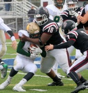 Darius Johnson of Elmira (18) tackles Matt Thrasher of Vestal on Oct. 20, 2018 at Ernie Davis Academy.