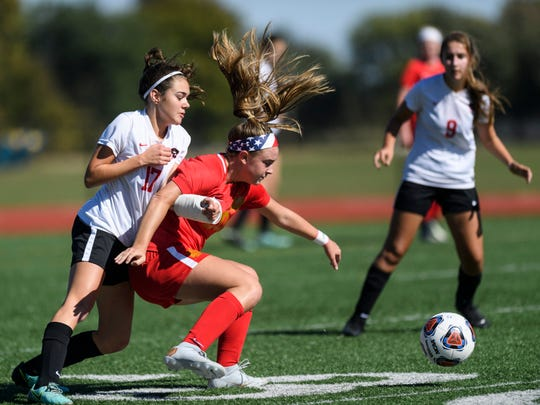Mater Dei's Emma Peerman (20) blocks Park Tudor's Gracie Whitacre (17) from the ball during an IHSAA Class 1A semistate match at Bundrant Stadium in Evansville, Ind., Saturday, Oct. 20, 2018. The Wildcats defeated the Lady Panthers, 2-0, to advance to next weekend's state championship match.