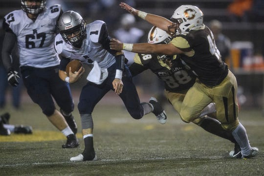 Reitz quarterback Eli Wiethop (1) runs from Central defenders in the sectional opener last week. The Bears defeated the Panthers, 30-14, to advance to the sectional semifinal against Northview.