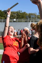 Mater Dei's Anna Bury (10) holds up the semistate champions plaque as she celebrates a 2-0 victory with her team in the Class 1A semistate match. The Wildcats advanced to the state championship game for the fourth time in five years.