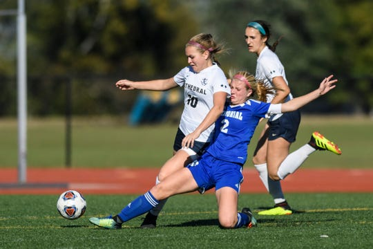 Memorial's Izzy Alexander (2) fight for possession of the ball during the IHSAA Class 2A semistate match against the Cathedral Fighting Irish at Bundrant Stadium in Evansville, Ind., Saturday, Oct. 20, 2018