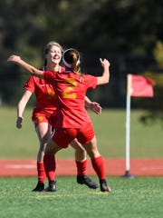 Mater Dei's Maddie Folz (14) receives a hug from her teammate Jenna Zirkelbach (2) after making a goal during the first half of the IHSAA Class 1A semistate match against the Park Tudor Panthers at Bundrant Stadium in Evansville, Ind., Saturday, Oct. 20, 2018. Folz scored the other goal in the second half to help the Wildcats secure a 2-0 victory over the Lady Panthers.