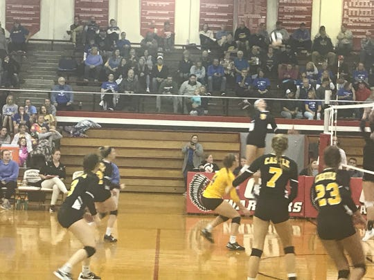 Jessica Nunge, preparing to spike against Jasper in Castle's victory in the Class 4A Harrison Sectional title match, was named All-Metro Player of the Year.