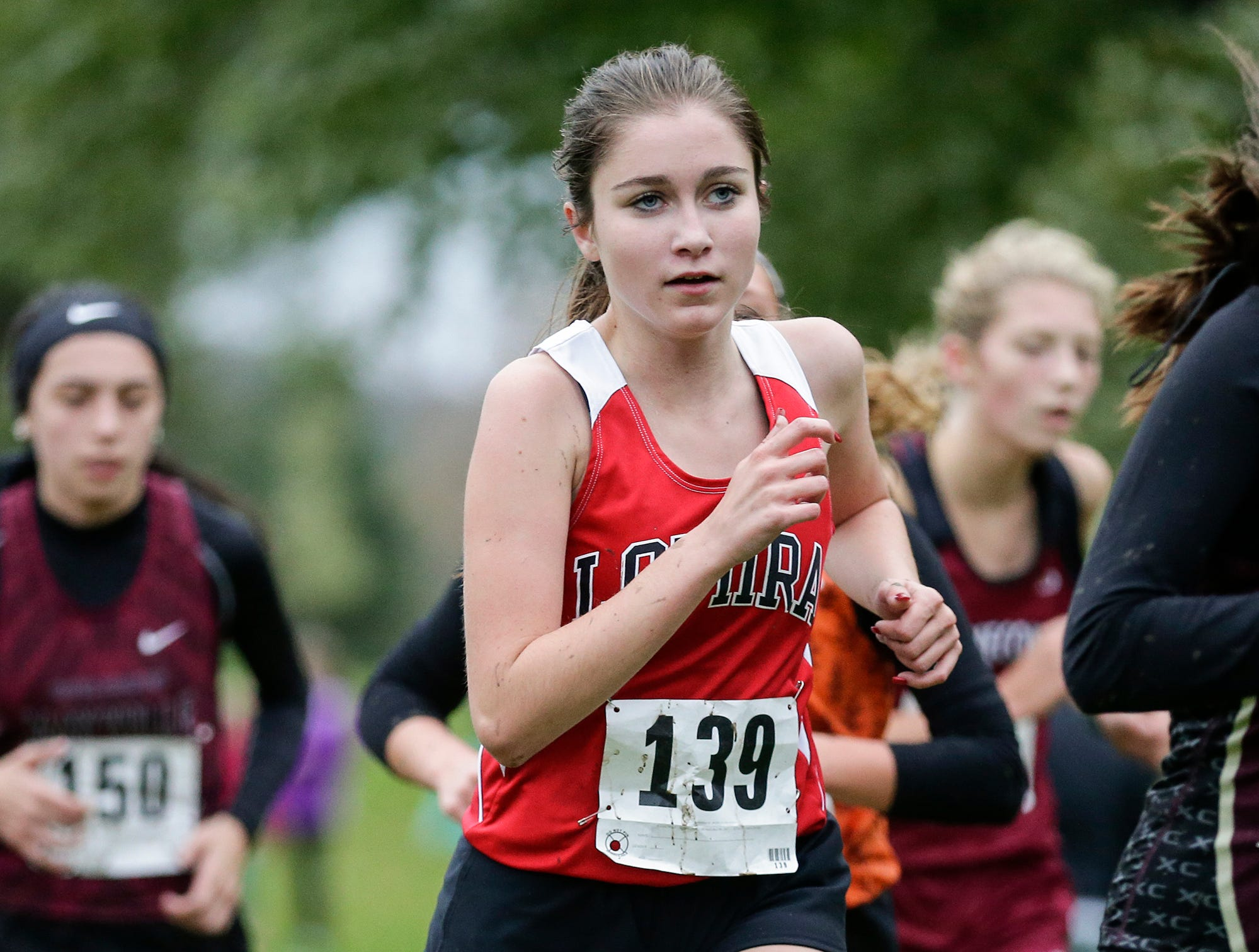 Lomira High School's Emilia Weiss runs in the WIAA Division two Mayville sectional cross country meet at the Mayville golf course Friday, October 19, 2018. Doug Raflik/USA TODAY NETWORK-Wisconsin