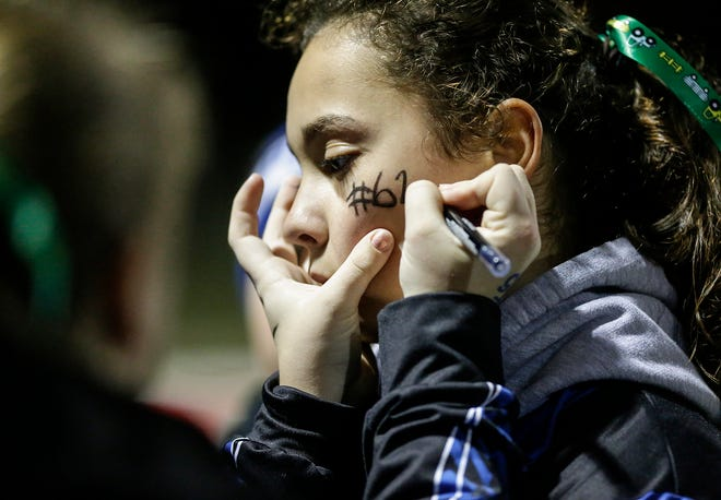 St. Mary's Springs football's cheerleaders wore #62 on their cheeks Friday, October 19, 2018 during their game against Dominican High School in Lomira, Wisconsin.  62 is the number of Springs player Trent Schueffner who was killed in a hunting accident earlier in the day in Calumet County. Springs went on to win the game 62-13. Doug Raflik/USA TODAY NETWORK-Wisconsin